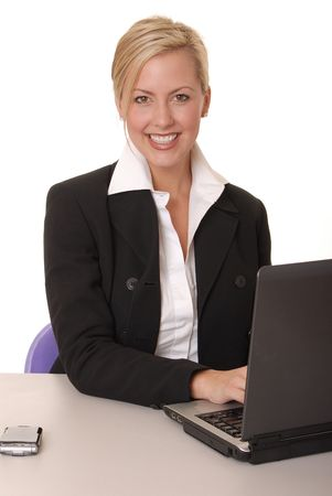 telephonist: Beautiful and sexy blond business woman with laptop Stock Photo