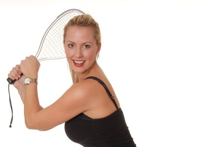 Sexy young blond girl with racket ball racket photo