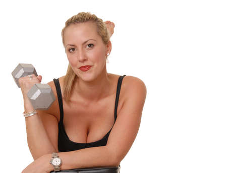 Beautiful blond girl working out with weights photo