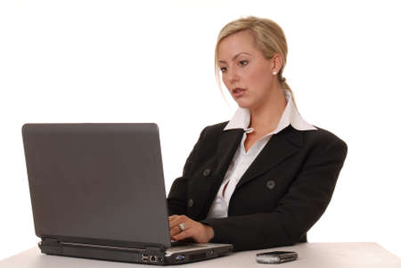 Beautiful and sexy blond business woman with laptop 版權商用圖片