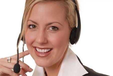 Mujer de negocios rubia hermosa y atractiva con el receptor de cabeza