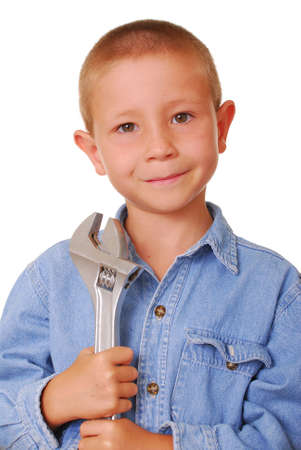 crescent wrench: Young boy with a crescent wrench