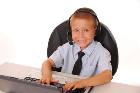 Boy at computer with headset on 版權商用圖片
