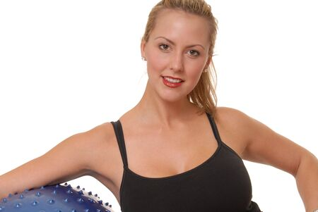 Beautiful blond girl working out with fitness ball photo