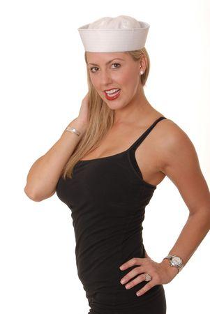 Belle fille blonde portant une casquette de marins Banque d'images - 609779