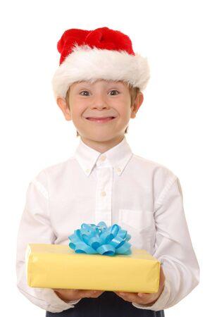 handsom: Handsom muchacho joven que llevaba un gorro de Pap� Noel y la celebraci�n de un regalo