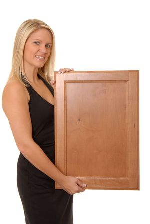Beautiful and sexy young blond girl isolatedholding a vlank wooden sign Stock Photo - 622887