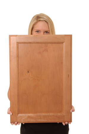 Beautiful and sexy young blond girl isolatedholding a vlank wooden sign Stock Photo - 622882