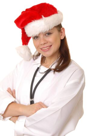 Lovely young and beautiful Doctor or Nurse wearing Santa Hat photo