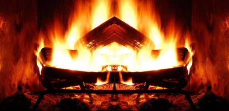 Closeup of roaring log fire in fireplace