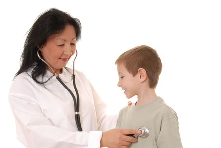 Lovely Doctor or Nurse examining a young boy patient Stock Photo