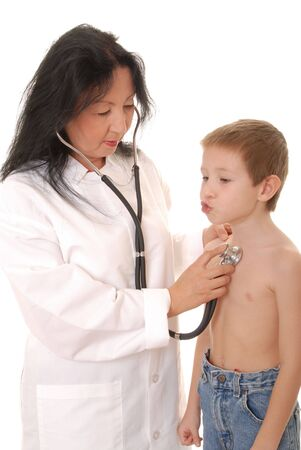 Lovely Doctor or Nurse examining a young boy patient Imagens