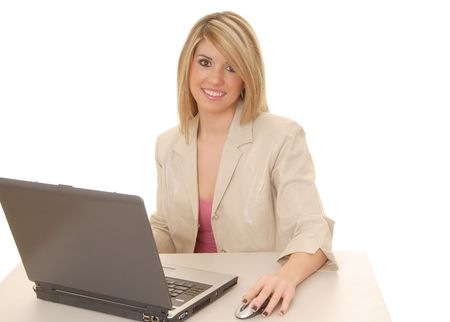 telephonist: Lovely blond business woman working at laptop computer