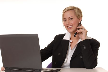 Lovely blond woman working at help desk photo