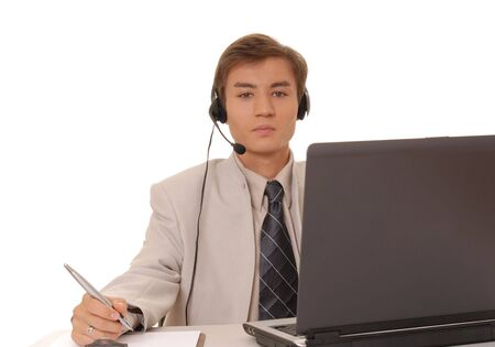 Handsome young business man at laptop computer