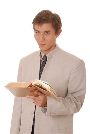 Handsome young business student with a book photo