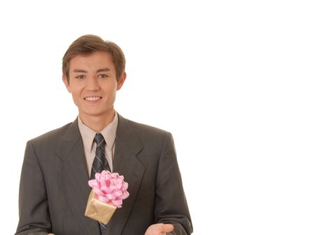 ess: Handsome young man carrying a wrapped gift