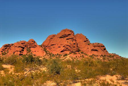 Dramatic desert mountains with a deep blue sky Banco de Imagens - 884289