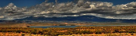 Dramatic desert mountains panorama with a storm approaching Banco de Imagens