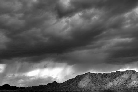 Dramatic desert mountains with a storm approaching in Black and white
