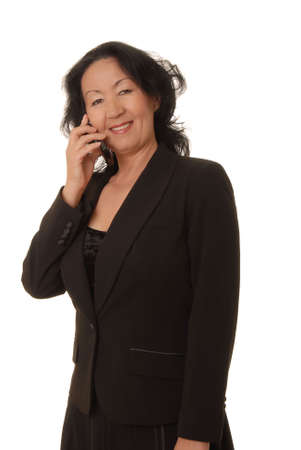 Portrait of a lovely asian business woman on a cell phone photo