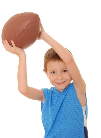 Young boy playing with an American style football isolated Stock Photo