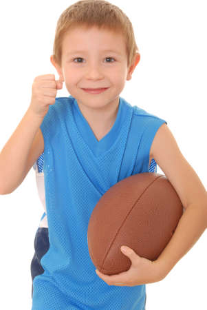 pigskin: Young boy playing with an American style football isolated Stock Photo