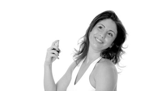 Sexy latina girl applying perfume from a spray bottle