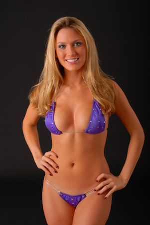 Isolated lovely and sexy young blond girl wearing a bikini Stock Photo