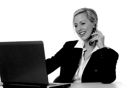 Laptop computer with a lovely blond on the screen Stock Photo - 2550834