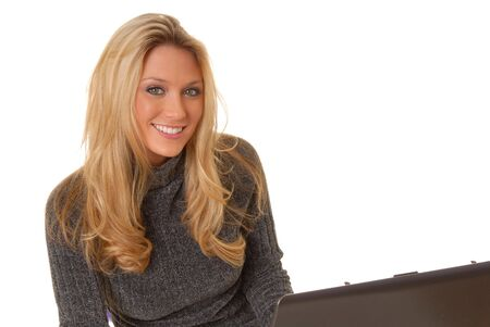 Laptop computer with a lovely blond on the screen Stock Photo - 2550931