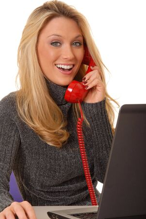 Laptop computer with a lovely blond on the screen Stock Photo - 2550948