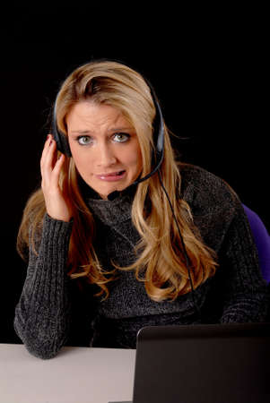 Lovely blond business woman working at laptop computer  photo