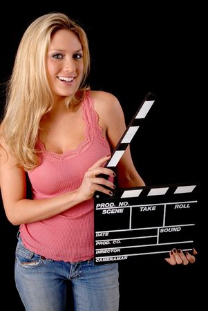 Isolated lovely and sexy young blond girl holding a clap board photo