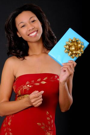 Isolated lovely and sexy young african american girl holding a wrapped package Stock Photo - 3025923