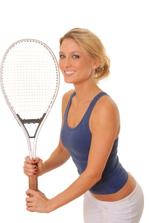 lovely blond girl with a tennis racket photo