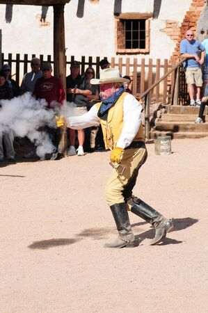 Goldfield, Arizona USA - January 16:  Unidentified Actor portraying Arizona gunfighter shooting on January 16, 2011 in ghost town Goldfield, Arizona USA