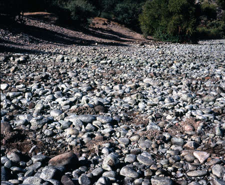 Dry and rocky river bed photo
