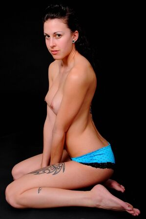 Young topless nude girl with tattoos and piercings Stock Photo - 8927928