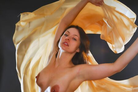 women breast: Lovely nude girl swinging daning with light fabric