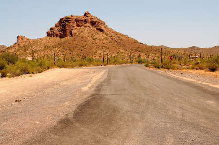 Road leading off into the desert mountains  photo