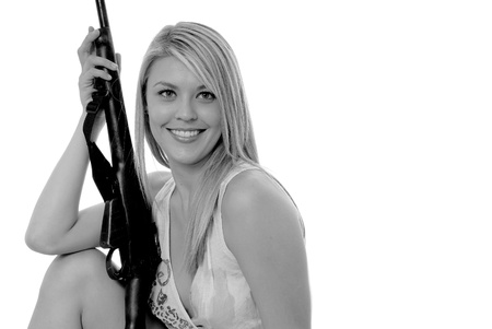 Lovely young blond girl with a rifle photo