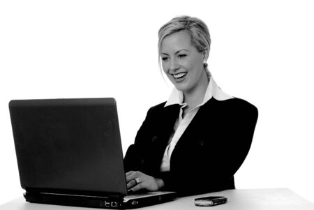 Lovely blond business woman working at computer laptop
