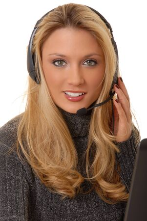 sexy office girl: Lovely blond business woman working at laptop computer