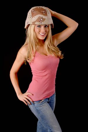Isolated lovely and sexy young blond girl wearing a military helmet photo