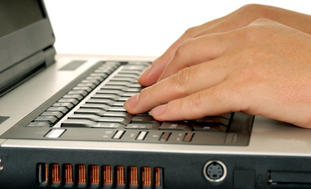 Fingers typing on a computer keyboard isolated Imagens