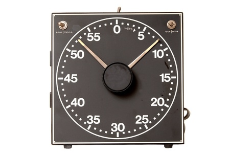 Detailed vintage darkroom timer isolated over white photo