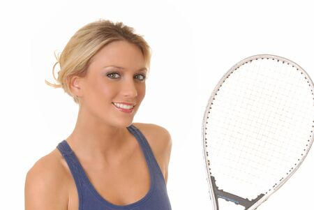 lovely girl with tennis racket isolated on white photo