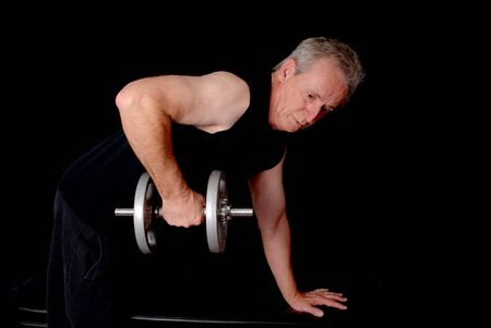workouts: Senior citizen fitness training by lifting weights