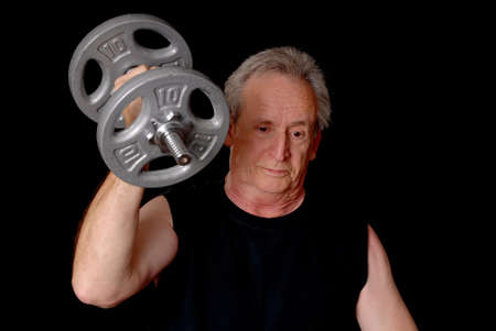manly man: Senior citizen fitness training by lifting weights
